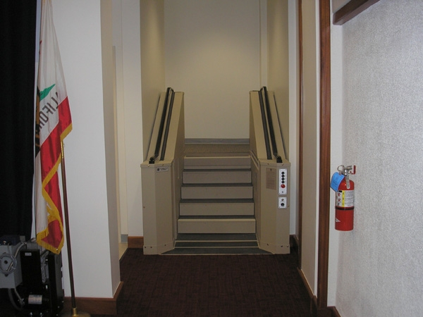 Tan in color. In step position for ambulatory access to exit boardroom. Lift function readily available, independently operable.