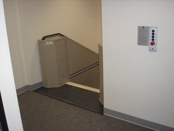 Tan in color. In step position for ambulatory access to boardroom from upper level approach. Lift function readily available, independently operable.