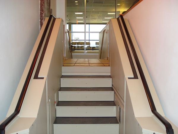 Tan in color. In step position for ambulatory access to restaurant. Lift function readily available, independently operable.