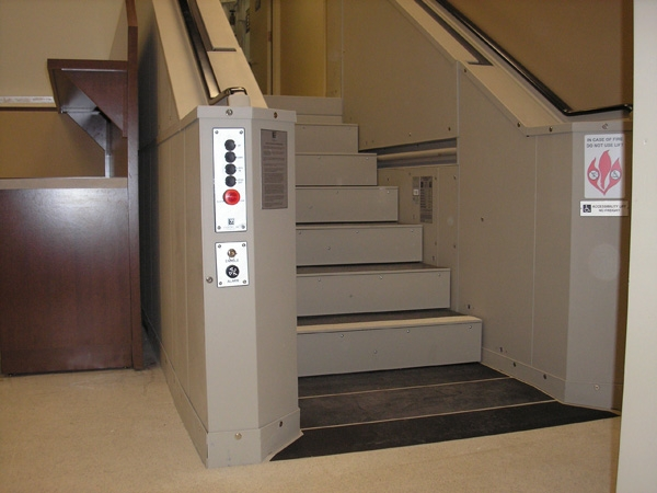 Tan in color. In step position for ambulatory access to hospital imaging room. Lift function readily available, independently operable.