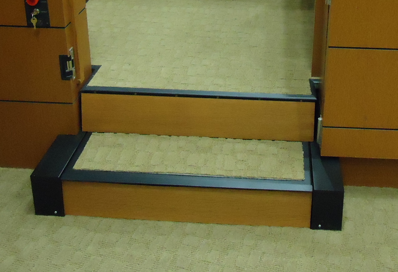 Close-up view of operable step in step position.