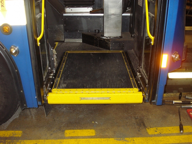 Ramp Conversion completed in front door of transit bus. Ramp is stowed.