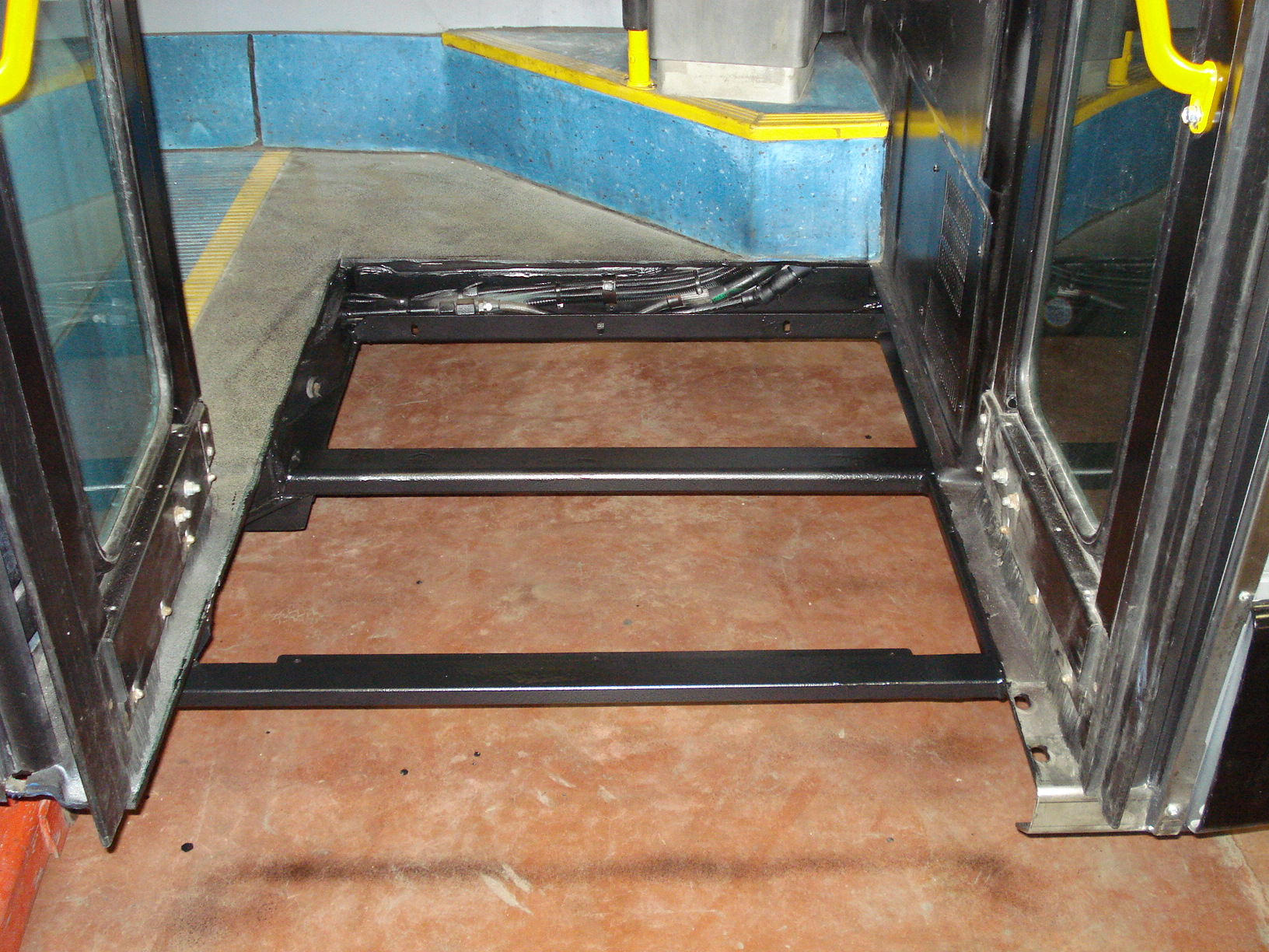 New ramp frame installed and painted after old ramp and frame removed.