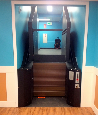 Black in color. Lift at upper level, providing access to employee breakroom.