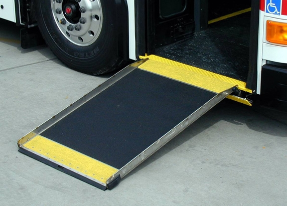 Ramp deployed to ground providing wheelchair access in to and out of the bus.