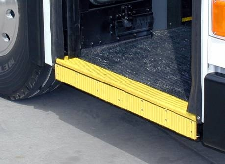 Ramp stowed in to the bus. Stowed ramp serves as floor in the entry way of the bus.