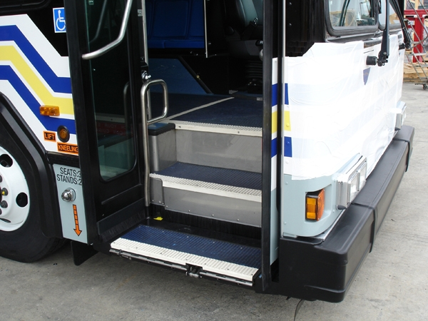 Lift stowed into the bus. Acts as bottom step for ambulatory access into the bus.